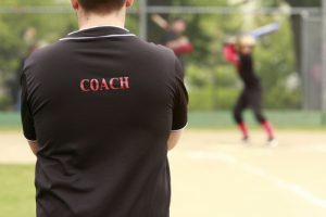 coach on softball field