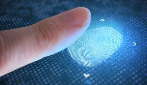 finger being scanned for fingerprints